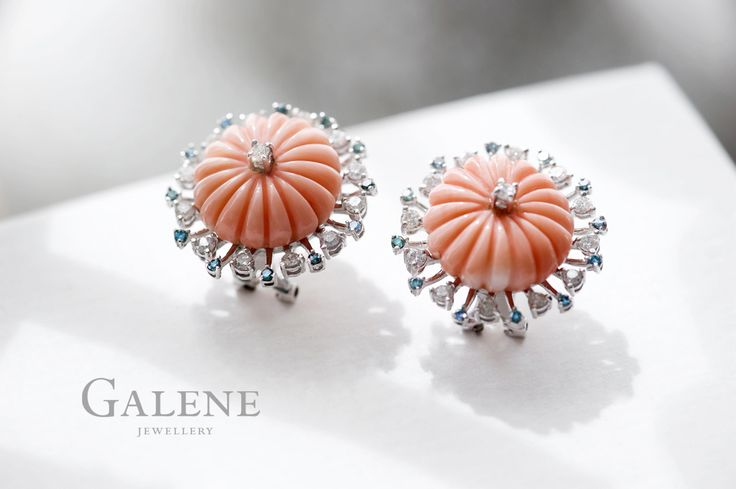 Carved Coral Earring / 18k white gold, 2 carved pink precious corals of 25.0 carats, 26 diamonds of 0.95 carats, and 24 blue diamonds of 0.31 carats.