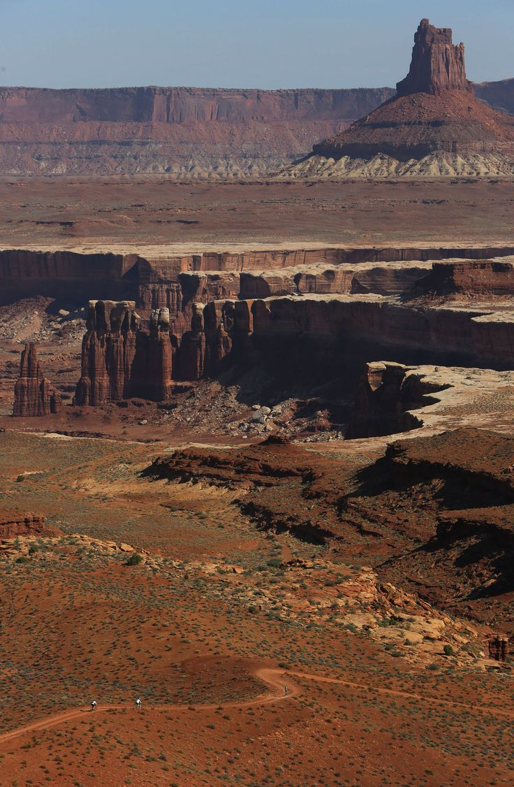 Mountain bikers ride the White Rim trail in Canyonlands National Park toward Candlestick Tower. (Francisco Kjolseth  |  The Salt Lake Tribune)