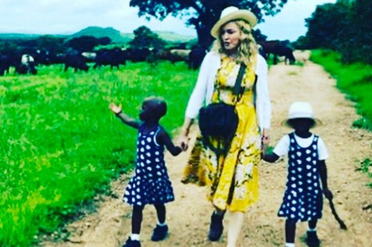 """Madonna has revealed she is """"overjoyed"""" after adopting twin sisters from Malawi. The Queen of Pop, 58, confirmed the news on Instagram where she posted a picture of herself walking hand in hand with her new daughters Stella and Esther   ᘡℓvᘠ □☆□ ❉ღϠ □☆□ ₡ღ✻↞❁✦彡●⊱❊⊰✦❁ ڿڰۣ❁ ℓα-ℓα-ℓα вσηηє νιє ♡༺✿༻♡·✳︎· ❀‿ ❀ ·✳︎· FR FEB 10 2017 ✨ gυяυ ✤ॐ ✧⚜✧ ❦♥⭐ ♢∘❃ ♦♡❊ нανє α ηι¢є ∂αу ❊ღ༺✿༻✨♥♫ ~*~ ♆❤ ♪♕✫❁✦⊱❊⊰●彡✦❁↠ ஜℓvஜ"""