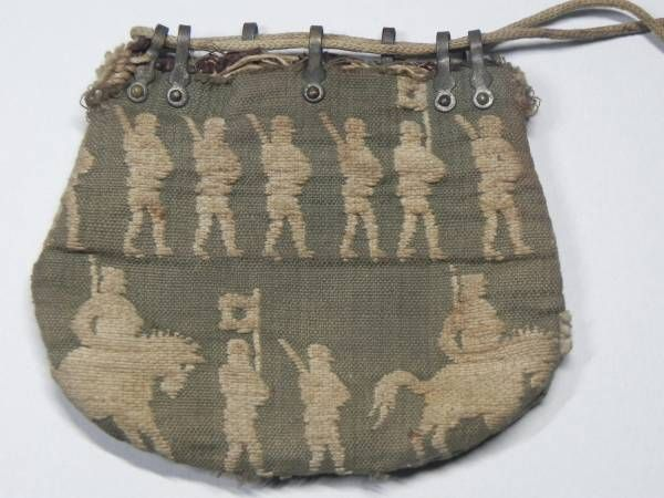 A small cotton supplementary weft bag featuring imperial Japanese soldiers marching. ht. approx. 7cm.