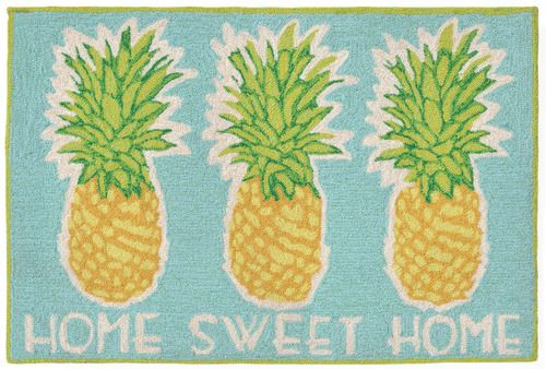 Such fun bright beach motif rug with pineapple images to welcome guests to your beach cottage by the sea!