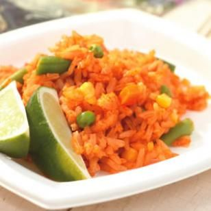 Nina's Mexican Rice ------------------------------ INGREDIENTS 2 tablespoons canola oil 1 cup long-grain white rice (see Brown Rice Variation) 1/2 cup finely chopped onion 1/4 teaspoon salt 1 tablespoon minced garlic 1 8-ounce can tomato sauce 1 1/2 cups reduced-sodium chicken broth or vegetable broth 1/2 cup frozen mixed vegetables (such as corn, peas and carrots), thawed