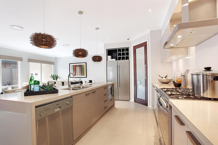Blonde cabinetry in kitchen with neutral bench top.