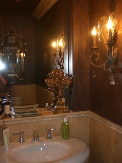 love this old world style half bath it looks very fancy not sure where