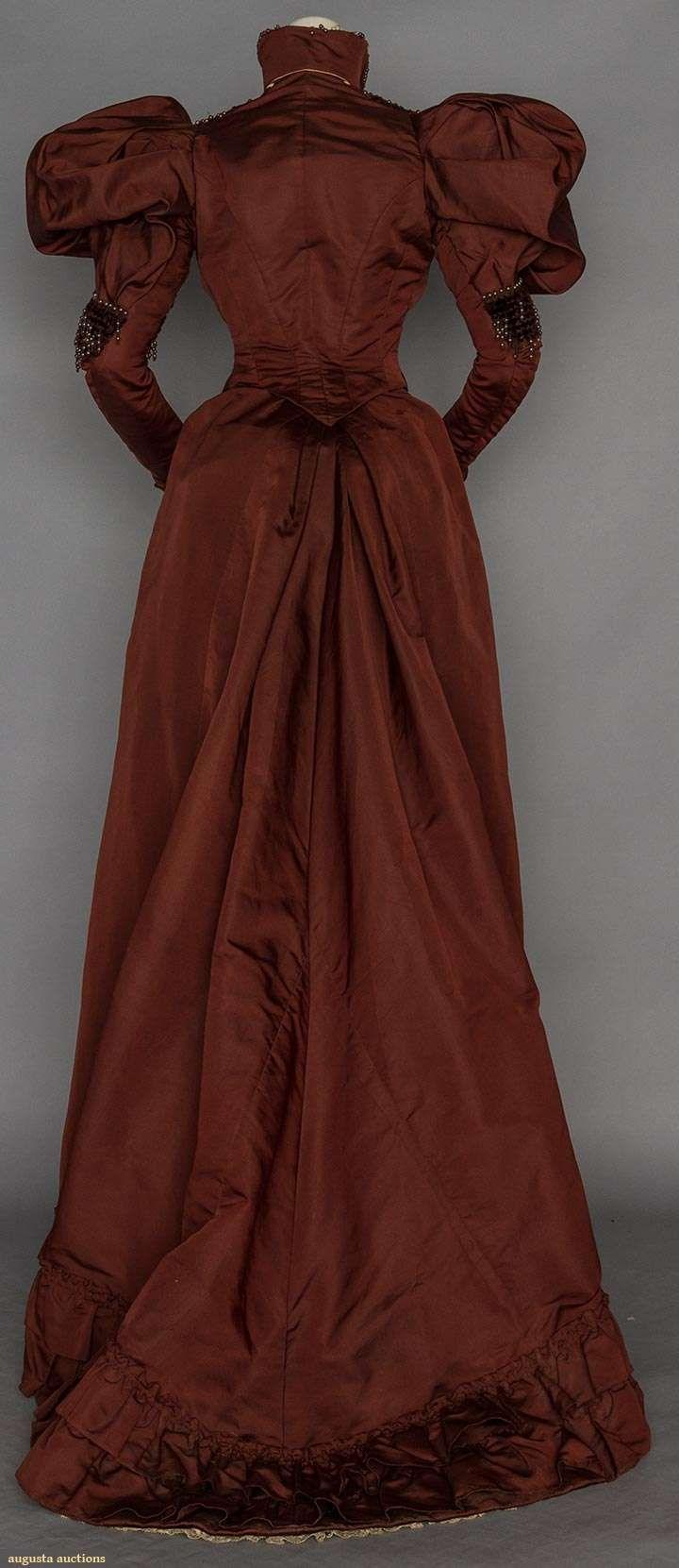 Dinner dress, chestnut satin, gigot sleeves & trim bands of brown velvet with grey pearl fringe, 1898