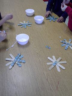 Snowflake craft stick ornaments. I have so many of those glass beads I could use