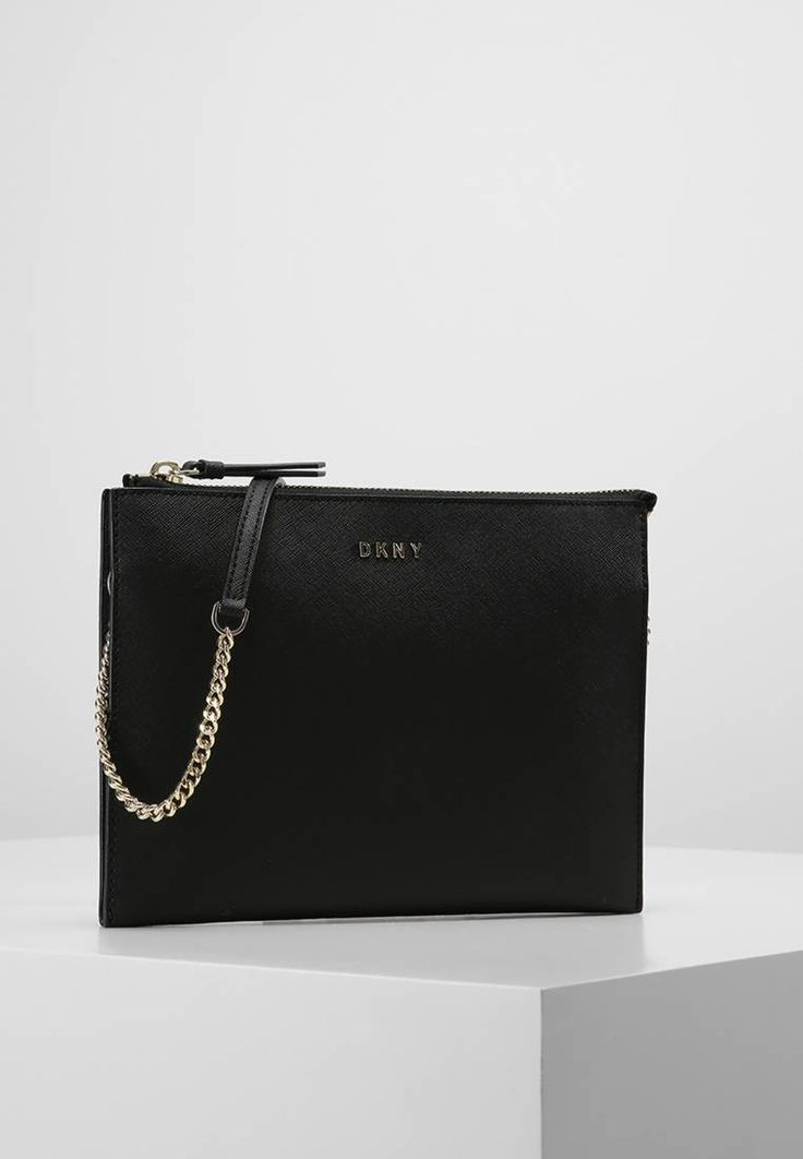 """DKNY. Clutch - black. Fastening:Zip. length:9.0 """" (Size One Size). width:1.0 """" (Size One Size). Lining:textile. Outer material:leather. height:7.0 """" (Size One Size)"""