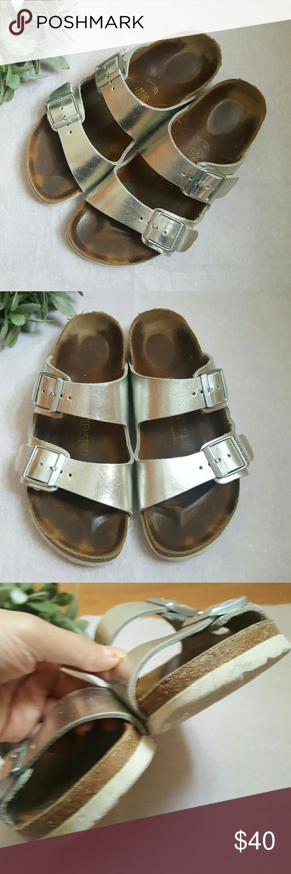 Birkenstock Silver Leather Sandals As pictured. Leather has some creasing and scratches. Overall in great pre-loved condition. These are a size 36 which converts to a US 5-5.5 Birkenstock Shoes Sandals