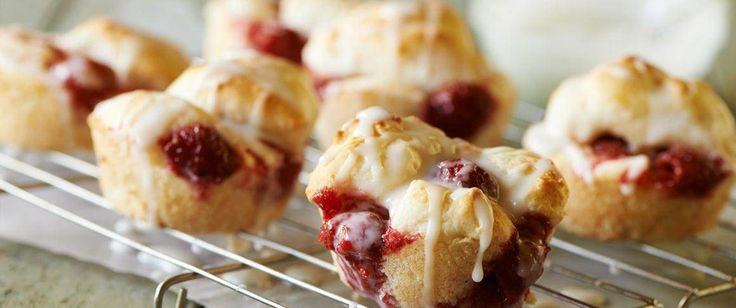 "A classic recipe from Betty's 1964 ""Bisquick Cookbook,"" these easy frosted muffins overflow with juicy fresh raspberries."