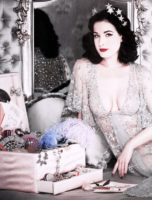 Dita Von Teese sorts through her jewelry box.  And that tiara is TO DIE FOR