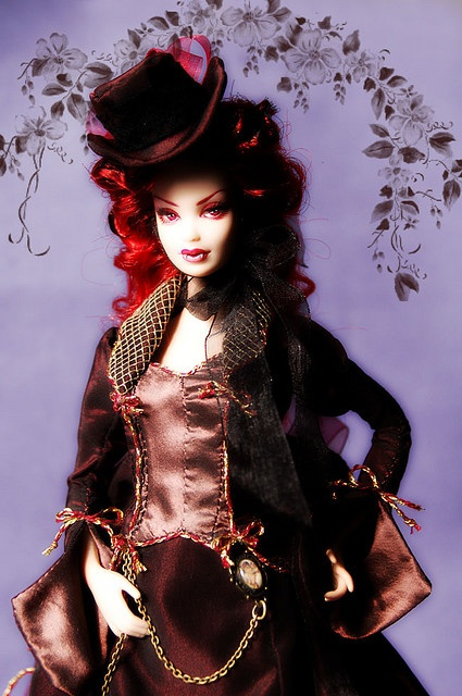 I'm partial to Tina Amantula's vampie barbies where the mouths are split open and fangs are added instead of painted, but this Victorian ooak Barbie rocks! - ooak Barbie