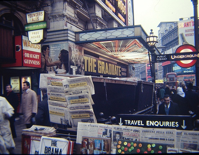 Piccadilly, December 1969. Ward's Irish Pub on the left which was a rough basement bar under the London Pavilion (converted from a disused part or section of the tube - former British Underground Railway toilets, at the corner of Shaftsbury Avenue/Coventry Street (under the old Wrigleys sign)