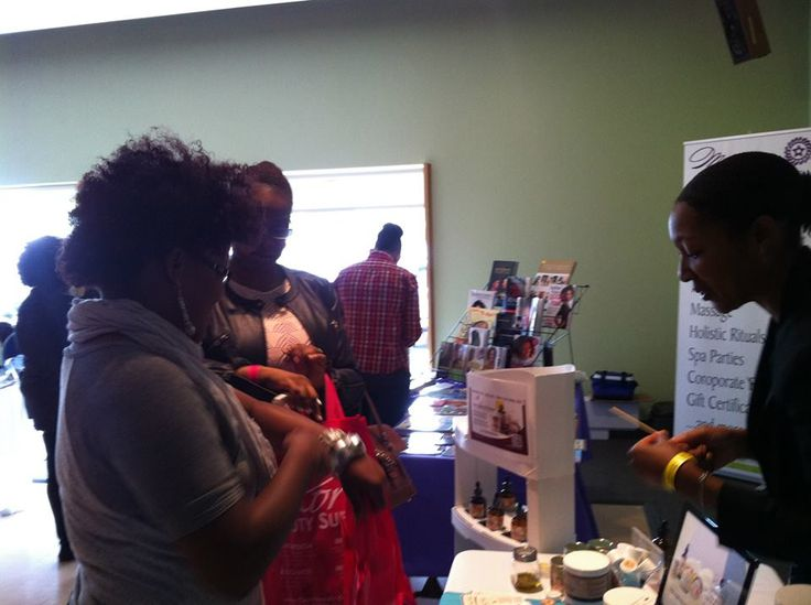 Ladies enjoying Pooka Guava mango body butter... a clear favourite at the booth. — at Toronto Natural Hair Show .