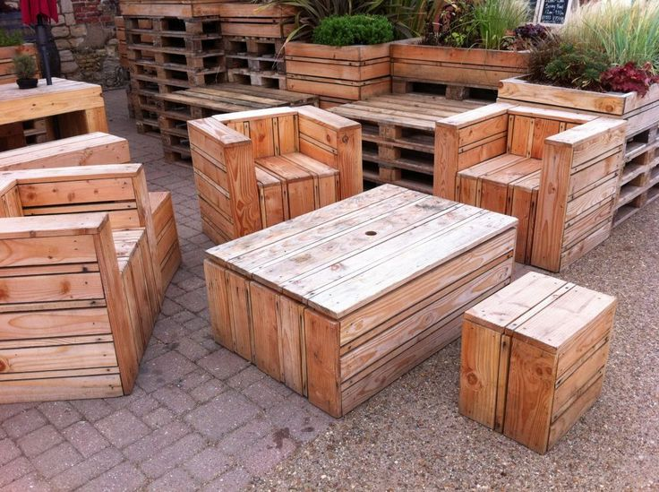 tables chairs made out of pallets at the quay side in kings lynn
