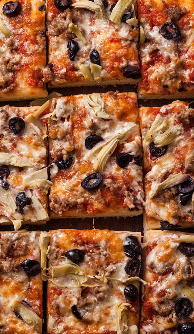 A classic focaccia pizza recipe. You will need to make our basic focaccia dough, then top it with tomatoes, artichoke hearts, mozzarella, sausage, and olives.