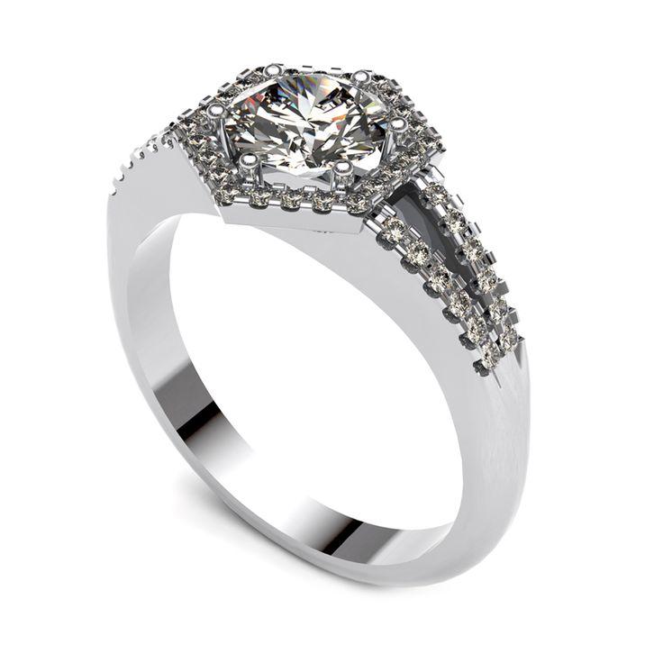 Diamond halo ring with diamond band.    www.uwekoetter.com