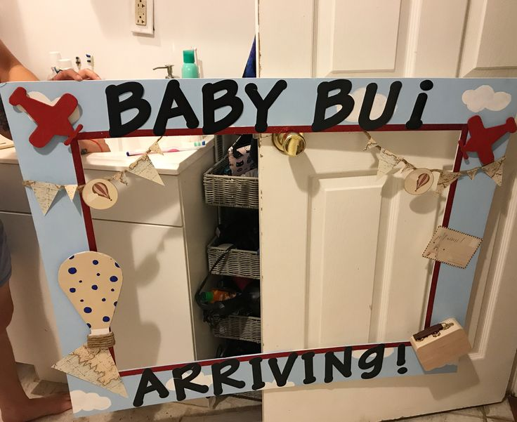 Made my own Travel theme baby shower photo frame. Props from AC Moore & Hot air balloon cut out from the left over board foam. Letters from staples
