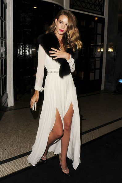 Glamorous Transformers actress Rosie Huntington Whiteley leaves the Moet & Chandon Etoile Awards party at Park Lane Hotel after Peruvian fashion photographer Mario Testino was given the inagural award during London Fashion Week 2011.