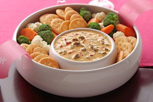Cheeseburger dip  1lb. (16 oz.) VELVEETA, cut into 1/2-inch cubes  1can (10 oz.) RO*TEL Diced Tomatoes & Green Chilies, undrained  1cup KRAFT Shredded Low-Moisture Part-Skim Mozzarella Cheese  1/2lb. ground beef, cooked, drained  4 green onions, sliced