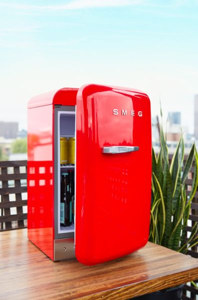 Available in a rainbow of bright and sleek hues, Smeg's retro-inspired mini fridge keeps drinks and snacks stylishly on hand.