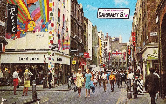 Statistically - if you hang around Carnaby street long enough,the chances are you will get vox-popped by a roving TV reporter or stopped by a canvasser. Before the days of being interviewed by a Channel 5 researcher asking what your favourite colour is, Carnaby street was the heart of Swinging Sixties London.    Some of these photos show the street in it's glory days in the late Sixties, including the polka dotted Mens boutique Lord John.