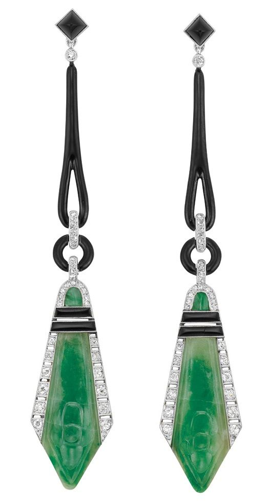 Pair of Art Deco Platinum, Black Onyx, Black Enamel, Diamond and Carved Jade Pendant-Earrings, France. Topped by 2 square-shaped sugarloaf cabochon black onyx, joined by tapered black enamel loops and black enamel circles flanked by diamond-set bands, suspending 2 fancy-shaped carved jade plaques, with French assay marks, circa 1920. #ArtDeco #earrings #EarPendants