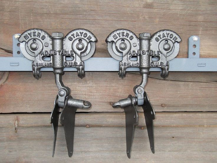 ONE PAIR OF ORIGINAL ANTIQUE F.E.MYERS STAYON BARN DOOR ROLLERS, MADE IN ASHLAND OHIO. THESE ORNATE BARN DOOR ROLLERS HAVE BEEN MEDIA BLASTED,PRIMED,PAINTED, DETAILED AND CLEAR COATED WITH A SATIN FINISH, ALL THE ADJUSTMENT NUTS TURN AND ALL THE WHEELS ROLL FREELY. | eBay!