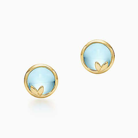 775.00 Paloma Picasso® Olive Leaf earrings in 18k gold with blue topazes.