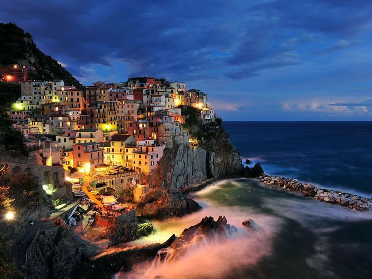 JUNE 17, 2010    Manarola, Italy  Photograph by Paul Hogie, My Shot    This Month in Photo of the Day: Travel    A scene of the tiny village of Manarola on the Cinque Terre coast of Italy. I camped on this spot for some time waiting for the right balance of light as the sun set. I was rewarded with many great shots of the late afternoon and even in moonlight. This long exposure captures the essence of the village with the locals all joining for a party near the boat ramp.: Cinqueterre, Bucket List, Manarola, Cinque Terre, Favorite Places, Beautiful, Places I D, Travel, Italy