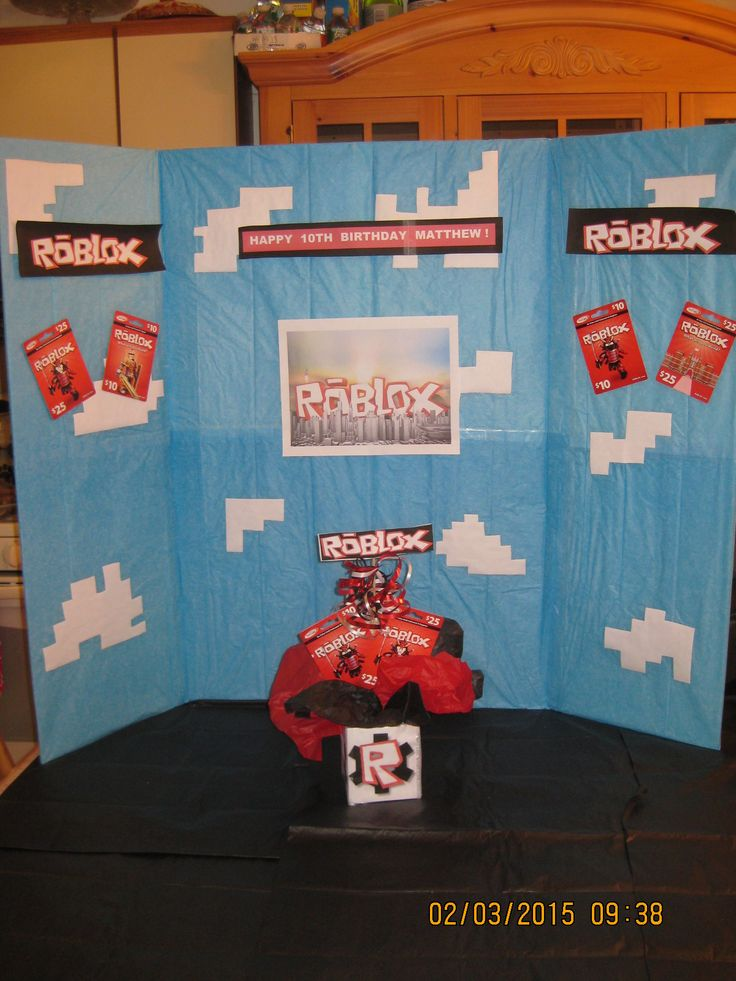 Roblox Birthday Party Table Centerpiece Decoration (Distant Front View)...I created this centerpiece for my son's upcoming party.  Note: Disregard the display board in the background...I'm still working out the details on this.  I'll post pictures to Pinterest later.