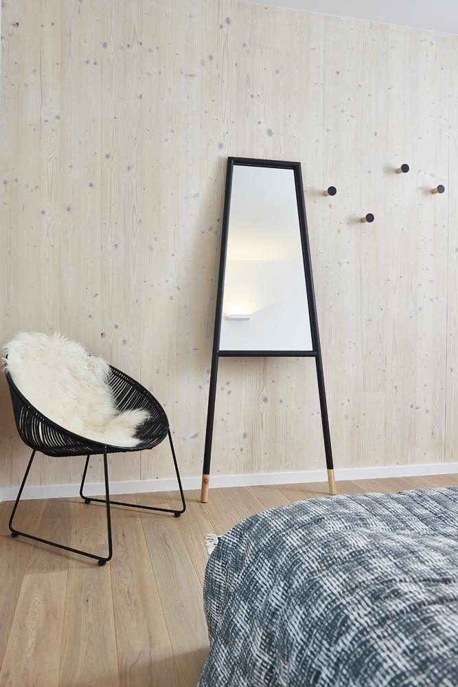 Rattan chair, lamb skin, mirror and hooks Bloomingville, bedding Ferm Living