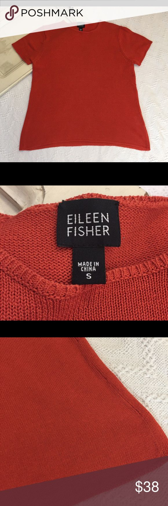 "Eileen Fisher Orange Short Sleeve Top size Small Eileen Fisher Orange Short Sleeve Top size Small.  This is a Knit, almost sweater like top, great wardrobe piece.  Gently used, no flaws.  Please see picture's.  Armpit to Armpit - 17.5""  Length - 21""   Thank you for shopping with us, we appreciate your business.  *All items are measured laying flat, please be sure to check sizing before purchasing. All brands do fit differently and all sales are final. I do my best to accurately describe all…"