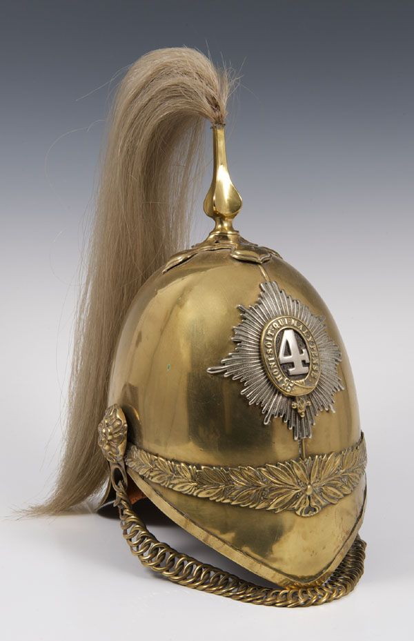 """1871 pattern brass 4th Dragoon Guards trooper helmet. The 4th Royal Irish Dragoon Guards, affectionately known as the """"Mounted Micks,"""" saw action with the heavy brigade in the Crimea, participating in the charge at Balaclava in 1854. Later they fought under Lord Wolseley at the Battle of Tel el-Kebir."""