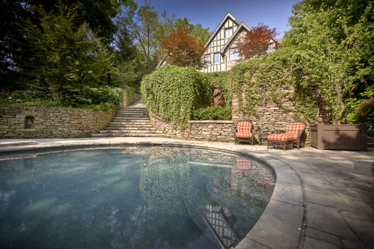 Stay cool by the pool with the elegant rubble stone wall and stairs. #stonework #rubble #pool