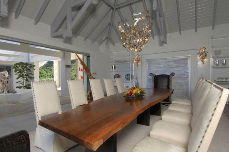 Decoration: Awesome Le Reve St Martin Beach House Dining Room Decor With Unique Chandeliers Above Wooden Dining Table And White Leather Chairs On White Rugs: Cozy Beach House For Vacation Places Idea