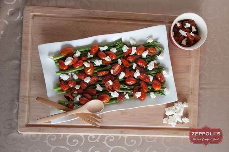 Asparagus and balsamic-glazed cherry tomatoes drizzled with goat cheese