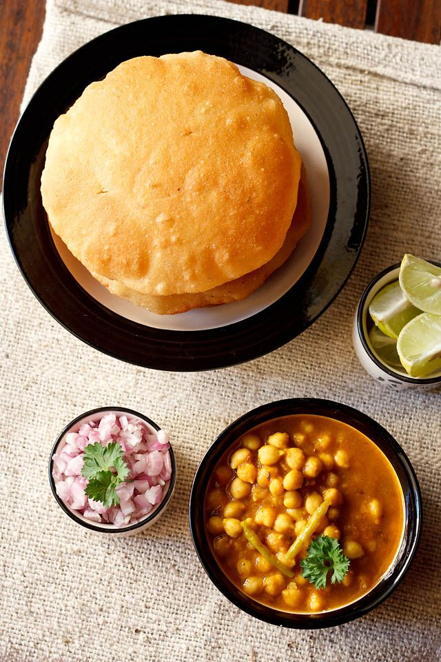 chole bhature – spicy chickpeas curry served with leavened fried bread. popular in punjab and parts of north india. #chole #whitechickpeas #bhature #bhatura #punjabirecipes #recipes