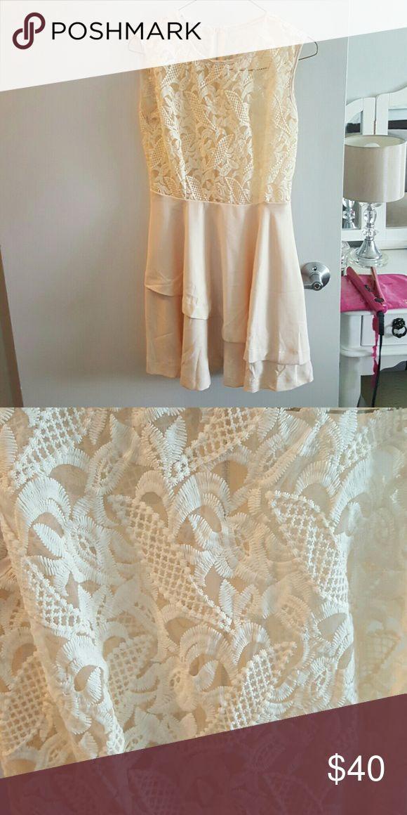Cream mini Dress with lace see through top Cream mini Dress with lace see through top. Never worn!!! Dresses Mini