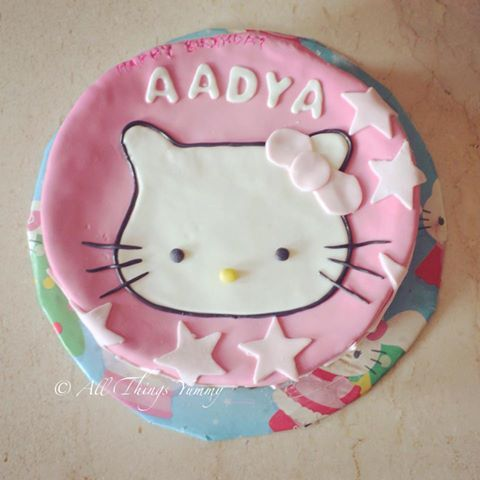 Cartoon Cakes - Pink Fondant Cartoon Cake of Hello Kitty for our little Aadya | All Things Yummy #allthingsyummy #fondant #cartoon #cakes #pink