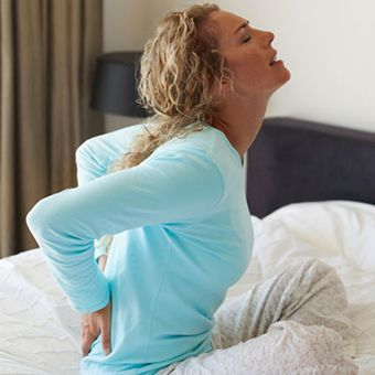 Get information on causes of mild to severe lower back pain (arthritis, pregnancy, herniated disc, sciatica, ovarian cysts). Read about low back pain symptoms, backache treatment, and diagnosis.