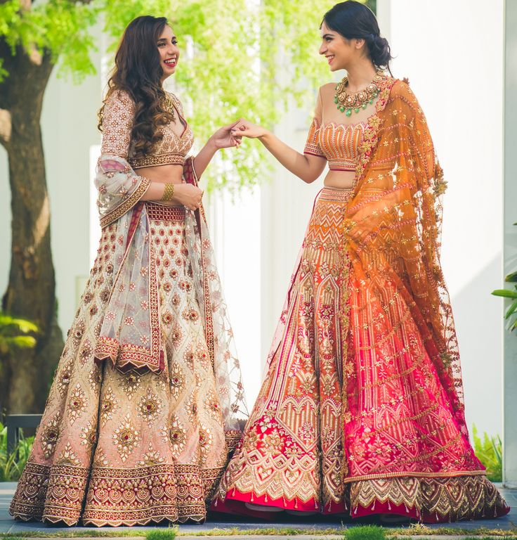 Sister of the Bride - Bride in a Yellow and Red Lehenga with the Sister in an Ombre Pink Lehenga with Blue Net Dupatta | WedMeGood #wedmegood #indianbride #sisterofthebride #sisterofthebrideoutfit #lehenga #bridal #wedmegood #redcarpet #taruntahiliani