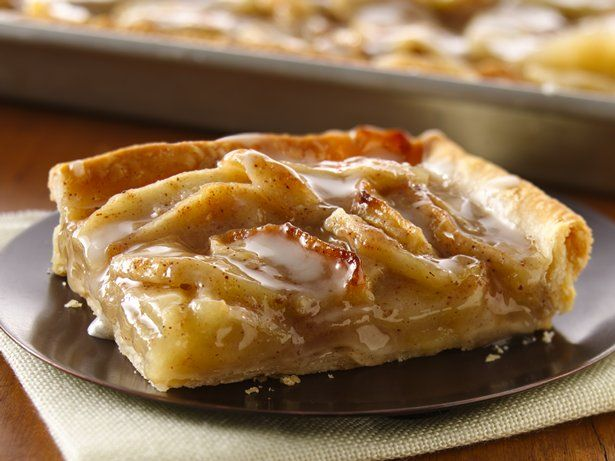 Pillsbury® pie crusts topped with a layer of spiced apple slices and drizzled with a sweet glaze — a perfect baked dessert for a crowd.