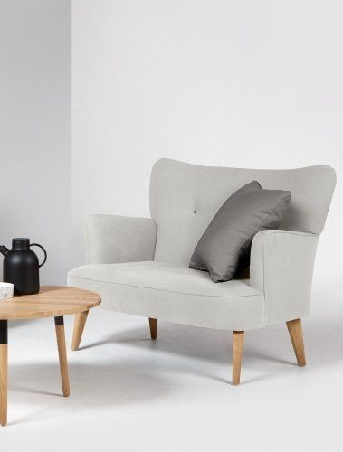 The Gigi love seat in soft dove grey. Rounded curves, wooden legs and cute buttons. £499 | MADE.COM