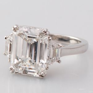 Emerald cut diamond 3-stone engagement ring