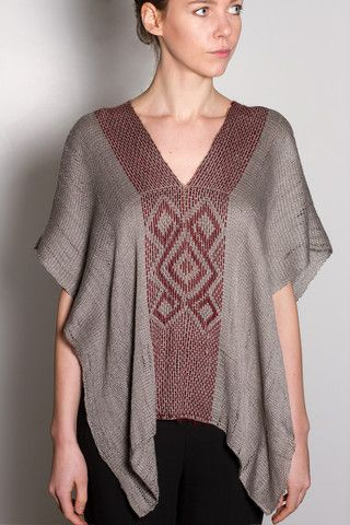 Hand-loomed pima cotton poncho. Available in gray with red symbol detail. One size only.