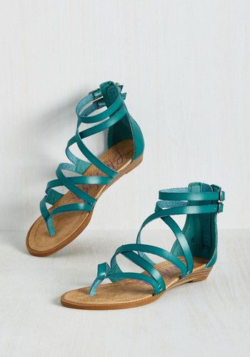 Once you zip into these teal sandals by Blowfish, it's a 'dune' deal - you're ready for the coast! Comprised of vegan faux-leather straps, antiqued gold buckles, and low, stacked wedges, this pair makes 'shore' you're prepared for the day's itinerary.