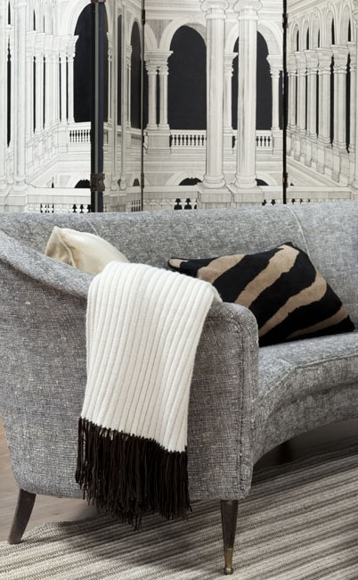 """Celerie Kemble on """"The Black and White Show"""" (Martha Stewart). Architectural Trompe L'Oeil painted room divider screen (Bizarre Bazaar), 1950's Italian curved back sofa (Flair Home Collection), belted stripe rug, 'Betwixt' pillow attributed to Dorothy Draper.  Photo by Hulya Kolabas. [3rd of three pins]"""