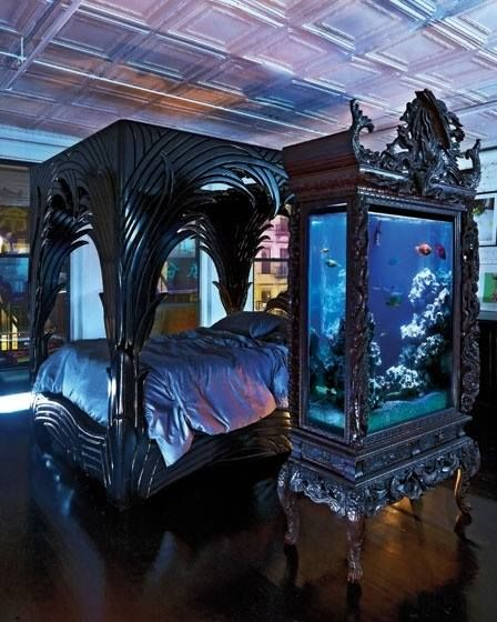 Dark, heavy and intensely ornate furniture - though I wouldn't be able to sleep with a fish tank that close to the bed.