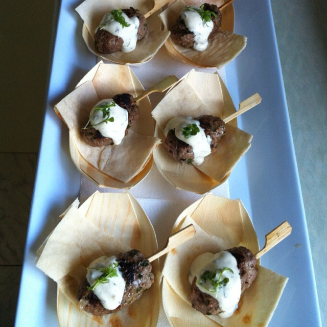 Lamb koftas with tzatziki and flat bread canapes for Bamboo canape boats