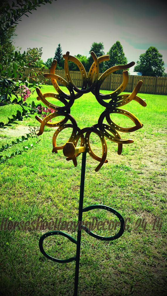 Hey, I found this really awesome Etsy listing at https://www.etsy.com/listing/194170324/horseshoe-flower-flower-pot-hanger